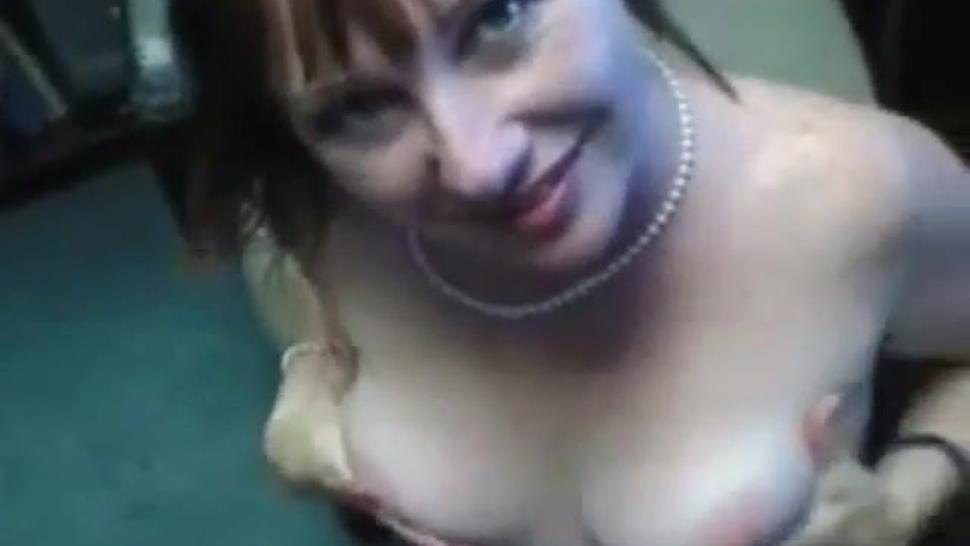 Redhead MILF happily takes a facial