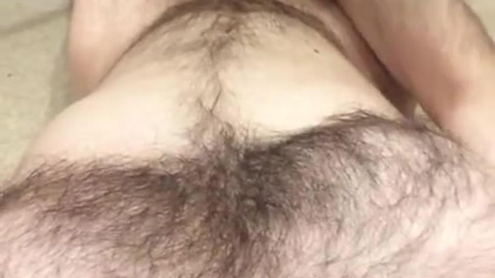 Hairy guy cumming solo