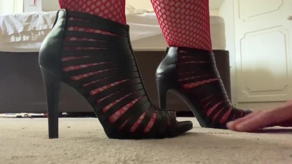 Mistress tramples hands in high heels