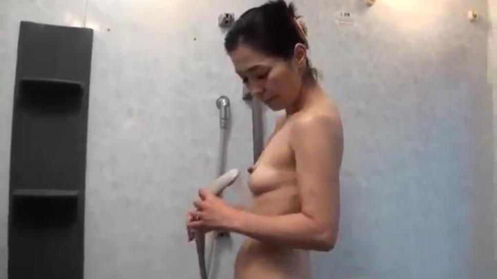 Sexy Japanese Cougar Bathing Young Dude Voyeur