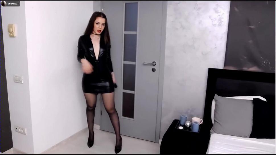beautiful brunette teasing in leather dress