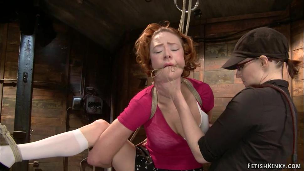 Redhead lesbian fingered on hogtie
