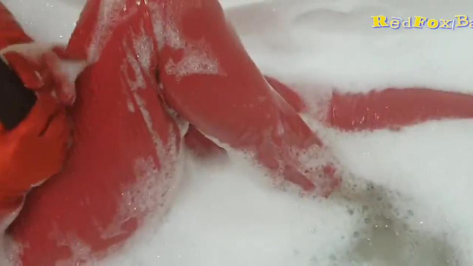Wet fetish in red latex milf playing with big black dildo in bath