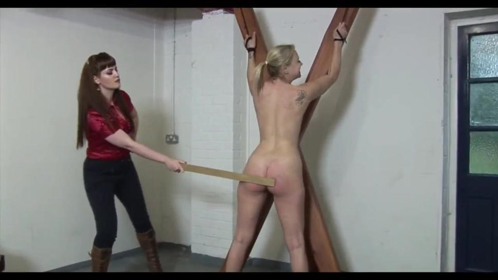 Blonde girl tied nude in the cross and paddled