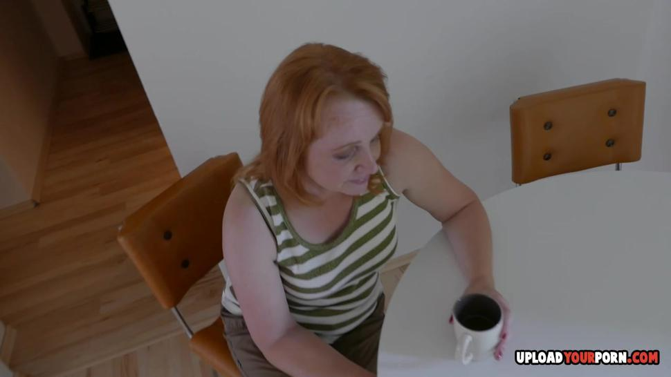 UPLOADYOURPORN - Mature redhead plays with her cunt for you