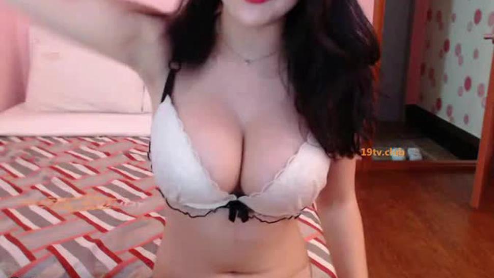 Busty Korean girl teasing her amazing boobs