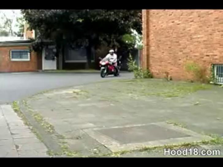 Hot ebony chick sucking a biker's cock