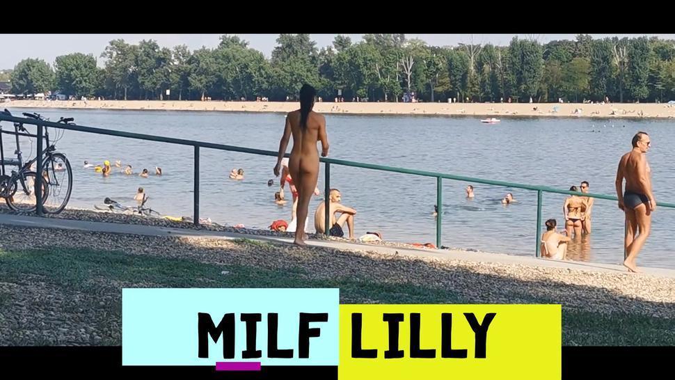 Milf Lilly completely naked on public beach asking for lighter