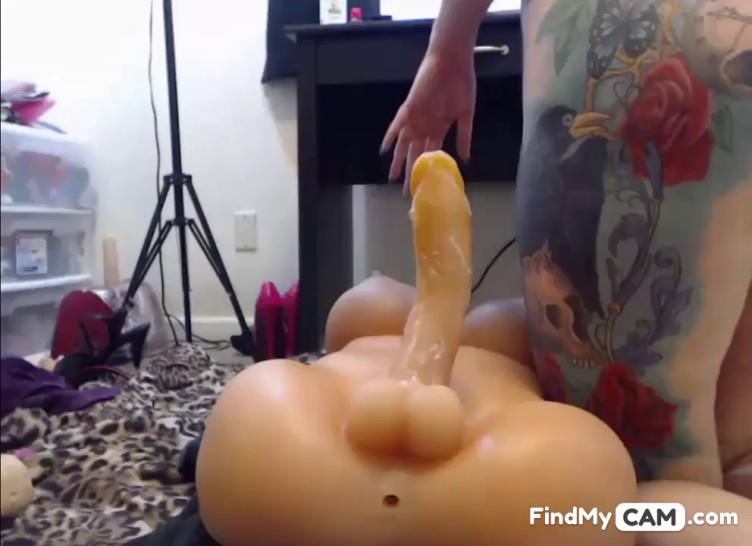 Busty Tattooed Girl Playing With Plastic Doll - video 1