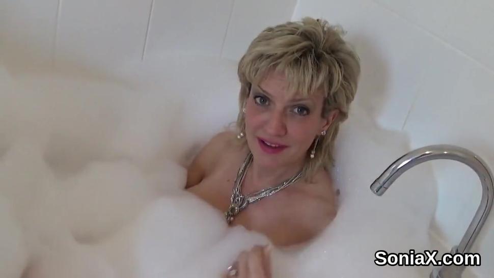 Adulterous british mature gill ellis exposes her gigantic tits