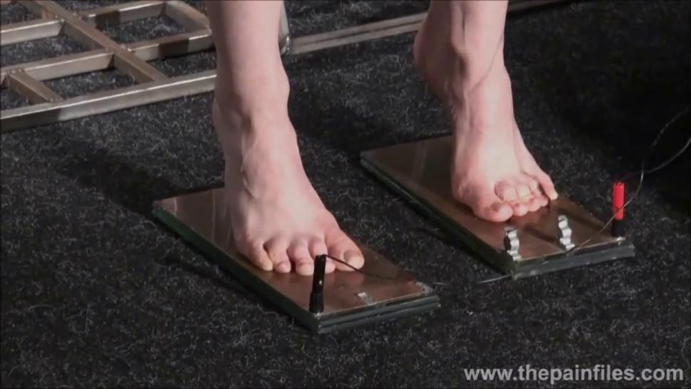 Electro bdsm and feet punishment of slave Elise Graves in dungeon tit torture and gruesome electric shock torments