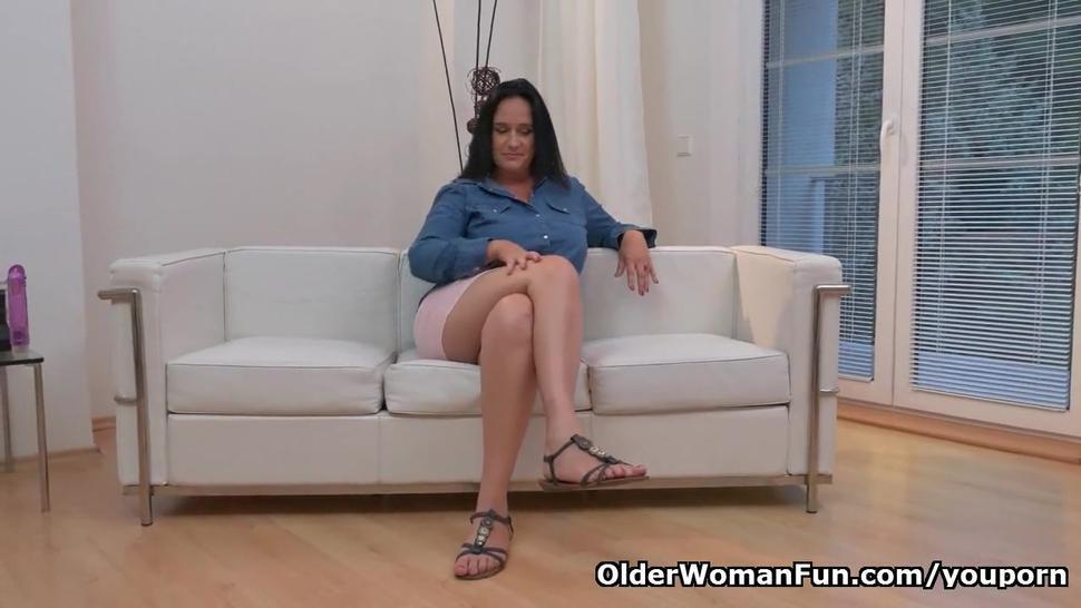 Euro milf Ria Black rubs her white cotton panties