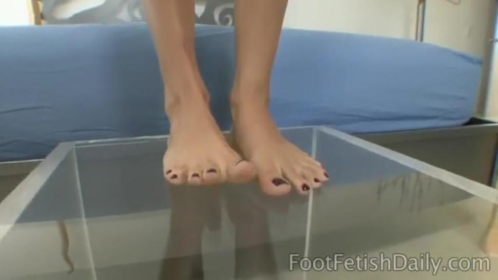 Soles on glass foot worship