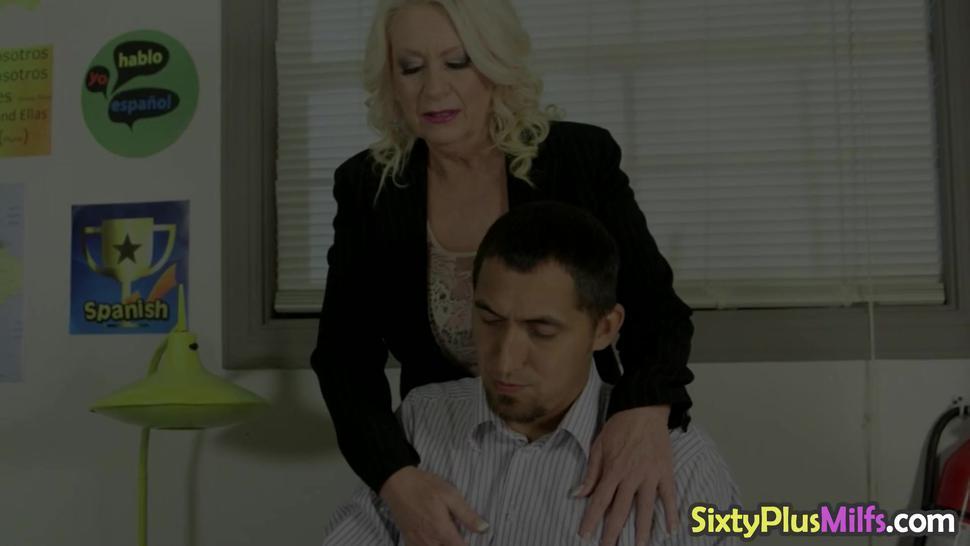 Blonde mature sucking hard cock on her knees