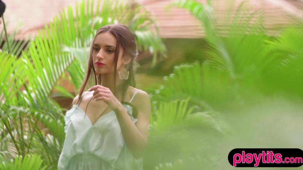 Beautiful brunette teen Gloria Sol erotic striptease outdoors