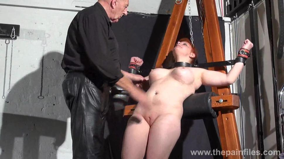 Swedish amateur submissive Vicky Valkyries dungeon bondage and whipping post spanking of chubby enslaved redhead in bdsm and pai