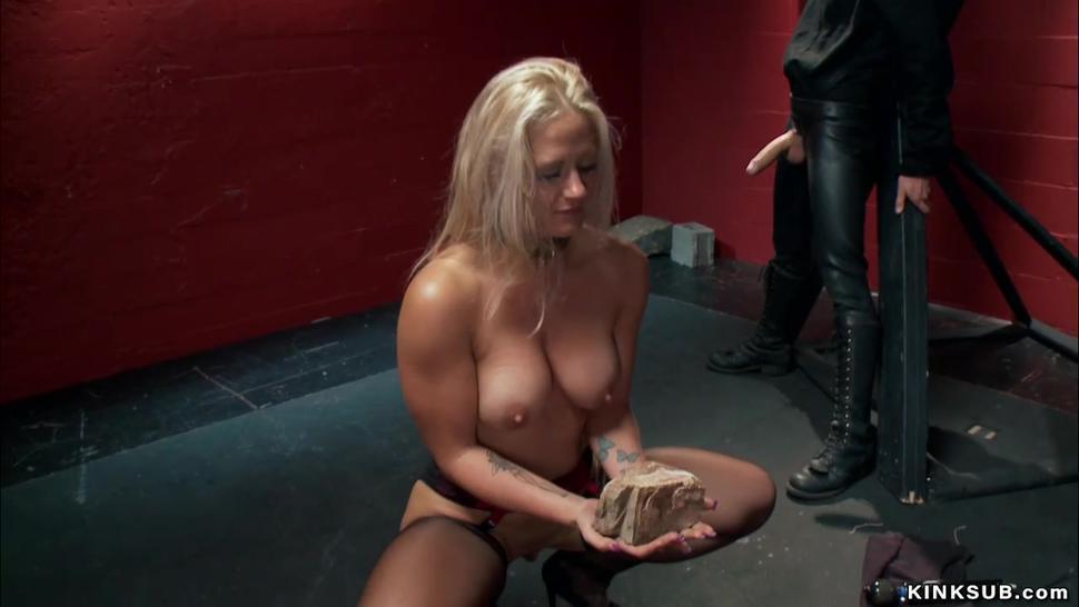 Busty blonde sucking huge dick to gimp