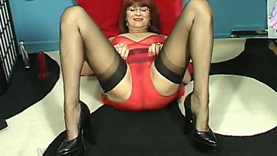 Very hot granny in lingerie and high heels masturbating with dildo