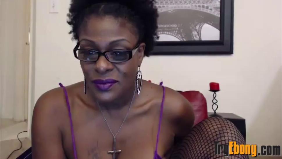 Ebony mature mistress with a hairy meaty vagina
