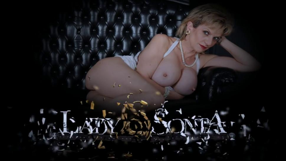 Mature blonde Lady Sonia uses a vibrator on her clit - video 1