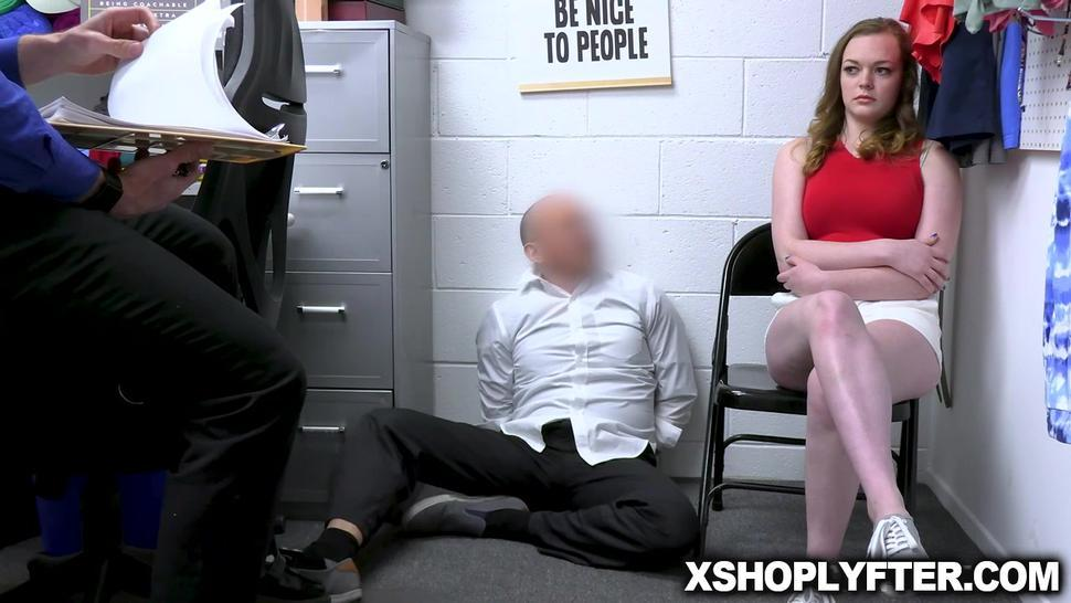Two officers submit Samantha to a cavity search