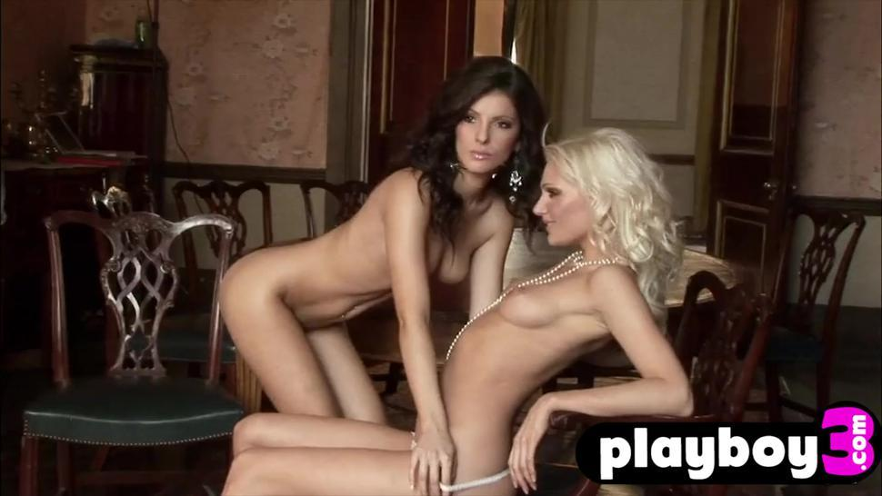 Huge tits model exposes her sexy body and posed with hot babe