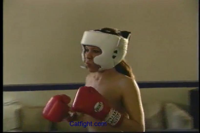 catfight Fierce topless female boxing with hard punches to the breast head belly and ribs to a tko ending