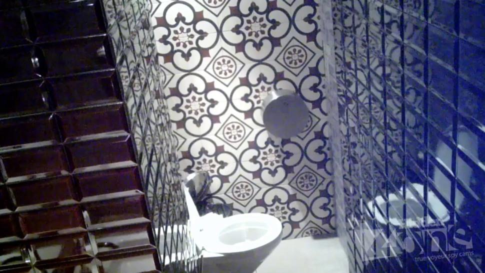 Women pee in public toilet 2330