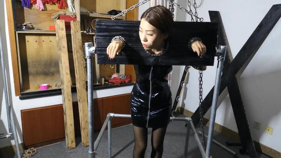 Asian Bondage Stock in Leather Dress