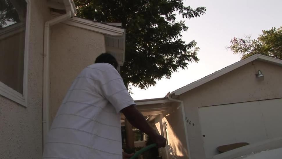 Fatty black wife helping husband washing car
