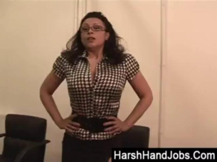 Mature secretary smacking a cock