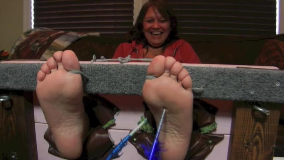 mature woman tickling feet