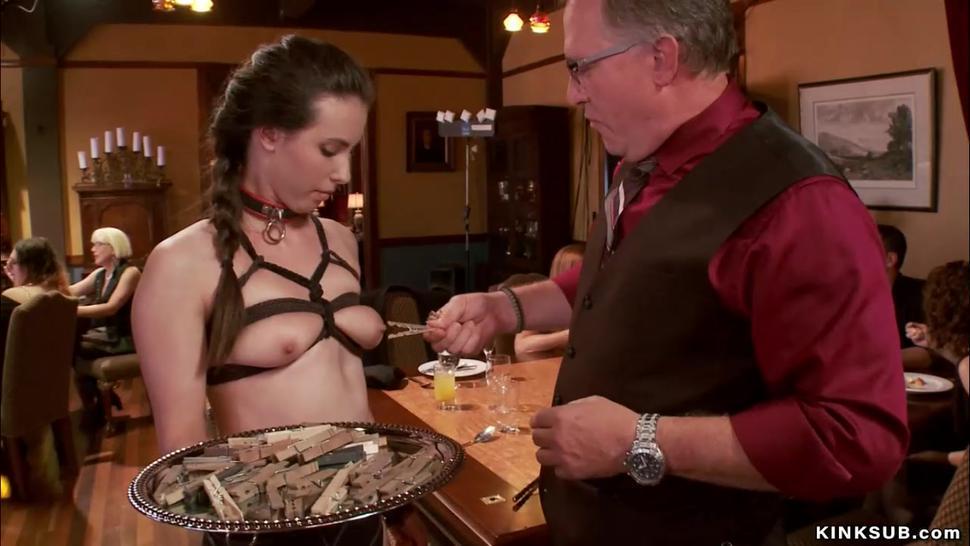 Slaves serving clothes pins at party