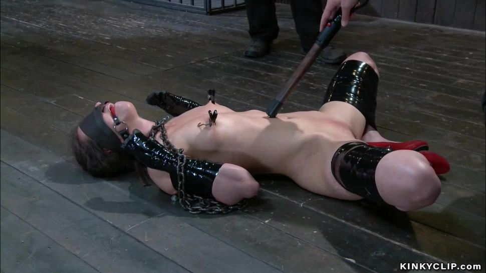 Slave whipped in pile driver bondage
