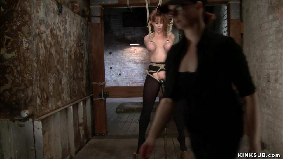 Lesbian in back arch bondage spanked