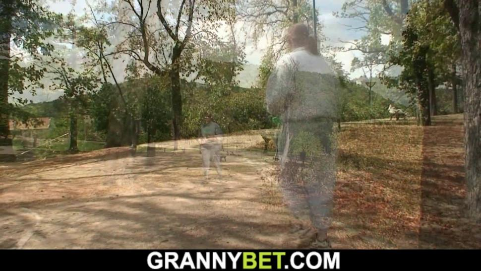 GRANNYBET - Old mature spreads legs for young stranger