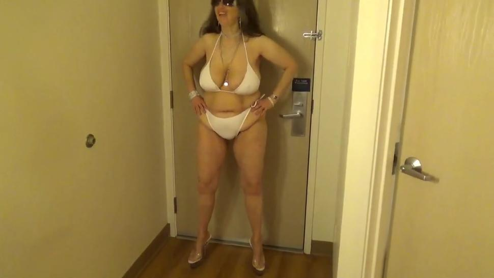 Tinja Stretches A White String Bikini in 6 Inch Stilettos