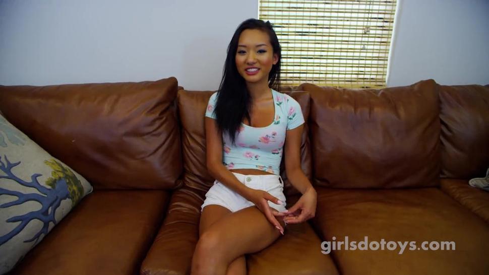 Sexy skinny asian teen fucks herself on kitchen table