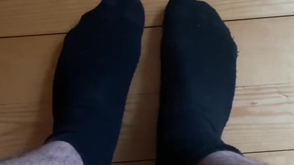 Shy boy shows his feet in dirty socks for satisfaction of his footfetish