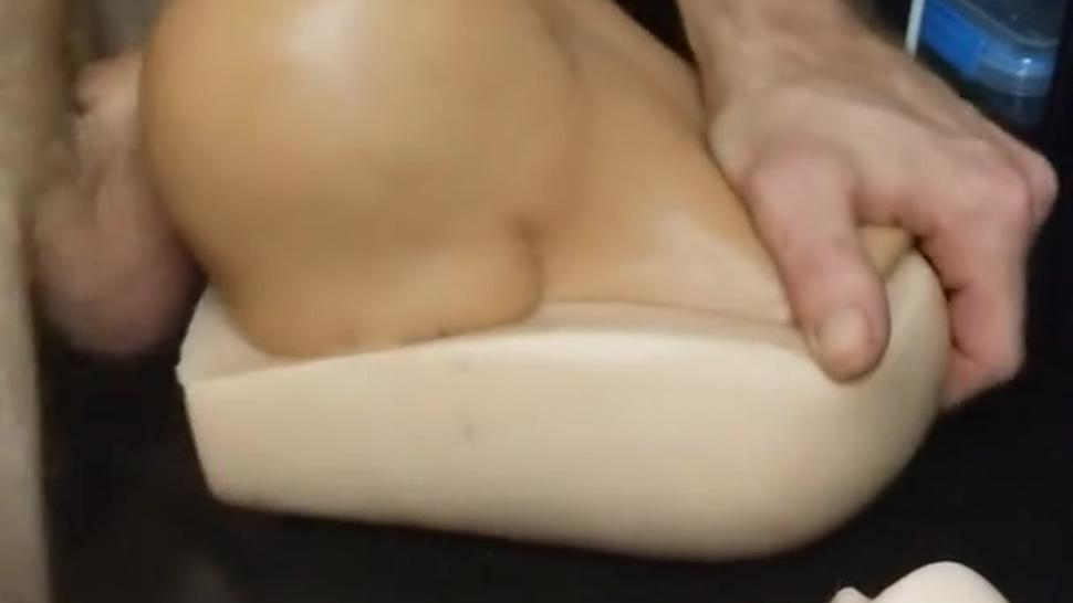 Using pocket pussy doggy style to jerk off solo while watching milf porn
