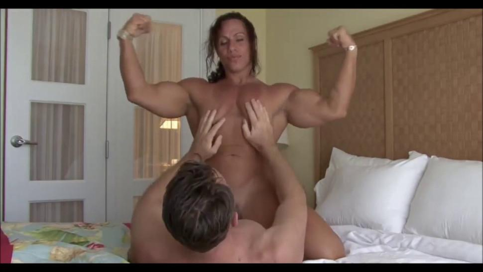 Female bodybuilder riding him