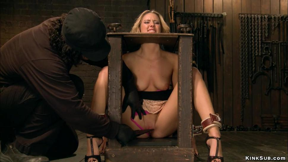 Blonde in back arch and stock bondage