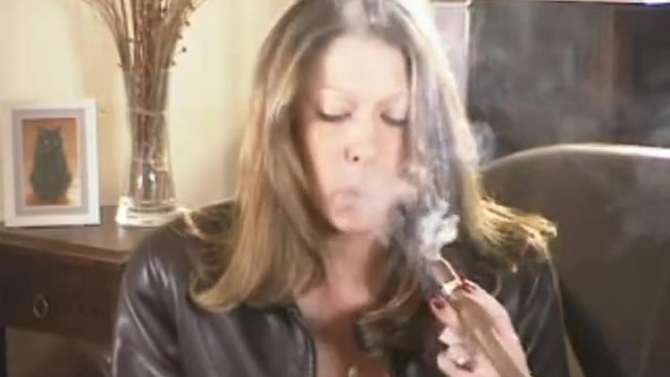 Lady In Leather Jacket Smoking Big Cigar Close Up