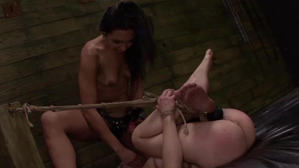 Brunette  roughed up in wild bondage