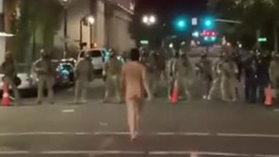 Naked Female Protester In Portland Faces Armed Police. Naked Athena She's Called