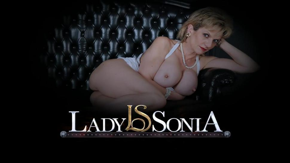 Busty milf Lady Sonia milking a huge cock on the gloryhole