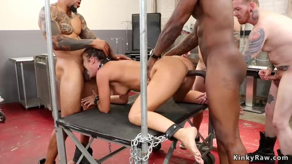 Brunette in gangbang doggy style sex