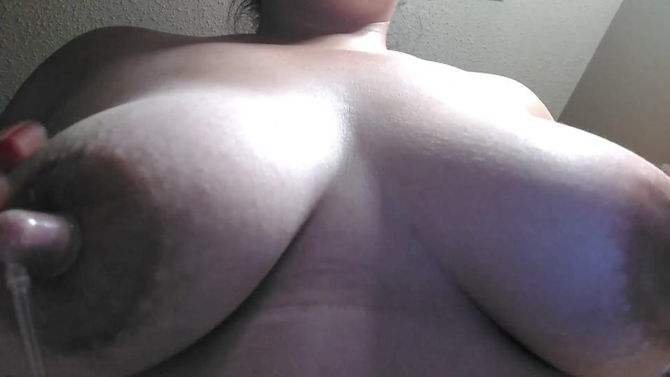 Chubby BBW playing with big boobs and hard nipples