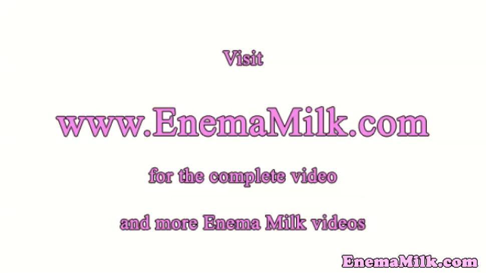 Milk enema lez with gaping asshole