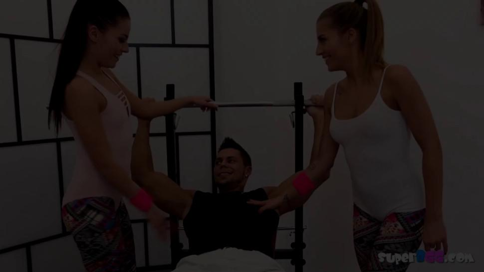 Personal trainer gets too personal with two sluts